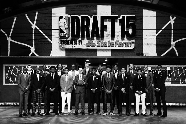 BROOKLYN, NY - JUNE 25: Front Row (L-R) Jerian Grant, Rondae Hollis-Jefferson, Justise Winslow,D'Angelo Russell, Adam Silver, Emmanuel Mudiay,Kelly Oubre, Devin Booker,Cameron Payne, Back Row (L-R) Sam Dekker,Bobby Portis,Willie Cauley-Stein,Kristaps Porzingis,Karl Anthony-Towns,Jahil Okafor,Frank Kaminski,Myles Turner,Trey Lyles,Kevon Looney pose for a group photo during the 2015 NBA Draft on June 25, 2015 at Barclays Center in Brooklyn, New York. NOTE TO USER: User expressly acknowledges and agrees that, by downloading and or using this photograph, User is consenting to the terms and conditions of the Getty Images License Agreement. Mandatory Copyright Notice: Copyright 2015 NBAE (Photo by Nathaniel S. Butler /NBAE via Getty Images)